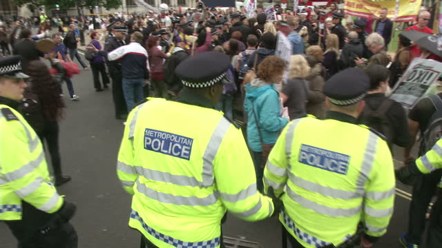 Exterior shots police officers moving antiausterity protesters out of the road outside the Houses of Parliament on budget day on July 08 2015 in...