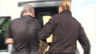 Exterior shots police officers removing bags of evidence from house of suspect arrested in relation to disappearance of Claudia Lawrence on May 13...