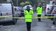 Exterior shots police officers stood by police tape with forensic officers at the scene outside the flat belonging to Vincent Tabak Police...