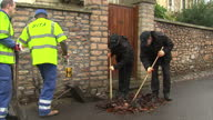 Exterior shots police searching for evidence in drains looking through leaves Police Searching Through Drains For Evidence on September 29 2011 in...