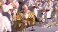 Exterior shots Pope Benedict XVI performing Holy Communion at Bellahouston Park Exterior pan crowds to Pope Benedict XVI sat on stage Pope Benedict...