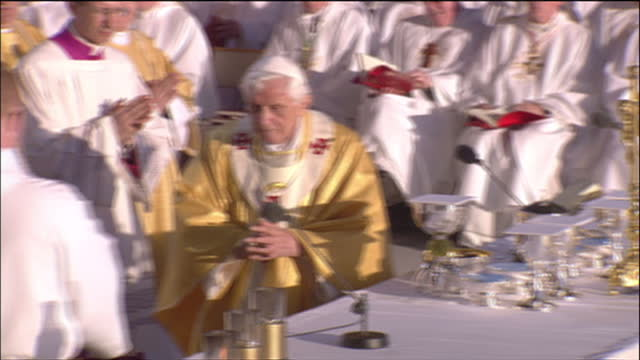 Exterior shots Pope Benedict XVI performing Holy Communion at Bellahouston Park Exterior pan crowds to Pope Benedict XVI sat on stage Pope Benedict...
