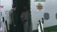 Exterior shots Pope Benedict XVI walks down plane steps at Edinburgh airport greets Prince Philip a hots of Cardinals before he walks past guard of...