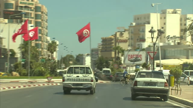 Exterior shots pov driving down road in Sousse past hotel resorts on the outskirts of the town on June 30 2015 in Sousse Tunisia