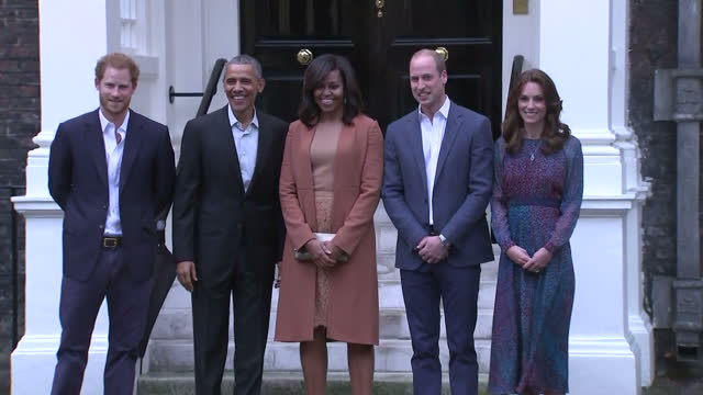 Exterior shots President Barack Obama Michelle Obama First Lady arrive at Kensington Palace and are greeted by Prince William Duke of Cambridge...