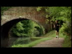 Exterior shots Prime Minister David Cameron jogging along towpath by canal David Cameron jogging on October 04 2010 in Birmingham England