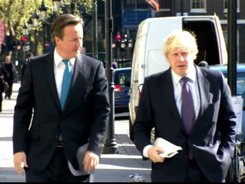 Exterior shots Prime Minister David Cameron Mayor for London Boris Johnson walk along street chatting before entering building David Cameron Boris...