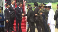 Exterior shots Prime Minister David Cameron walks down British Airways plane steps with aides greet Indonesia dignitaries military personnel Exterior...