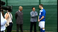 Exterior shots Prince Charles and Ant Dec talking to inmate Thomas Lloyd who is taking part in the 'Get Started with Football' programme run by the...