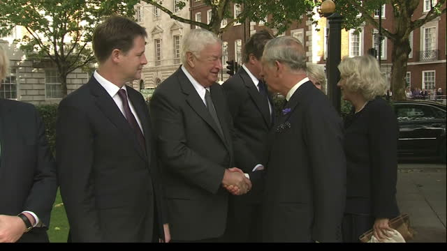 Exterior shots Prince Charles Camilla arrive at the 911 memorial in the grounds of the US Embassy in Grosvenor Square greet David Cameron American...