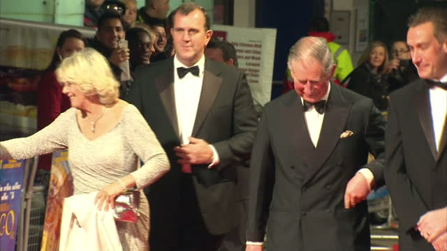 Exterior shots Prince Charles Camilla Duchess of Cornwall arrive on the red carpet at the premiere of Hugo Charles Camilla Arrive at Hugo Premiere on...