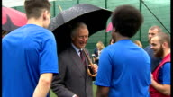 Exterior shots Prince Charles talking to inmates taking part in 'Get Started with Football' programme run by the Prince's Trust at HMP Parc Bridgend...