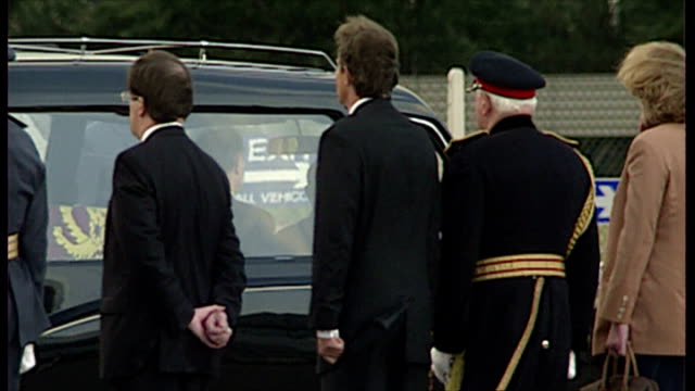 Exterior shots Prince Charles Tony Blair George Robertson line up as coffin placed in hearseo n in London England