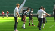 Exterior shots Prince Harry in rugby training session with young boys team Prince Harry In Rugby Training Match at Twickenham Stadium on October 17...