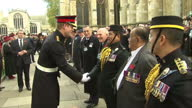 Exterior shots Prince Harry meeting servicemen veteran soldiers tip hats an salute the Prince