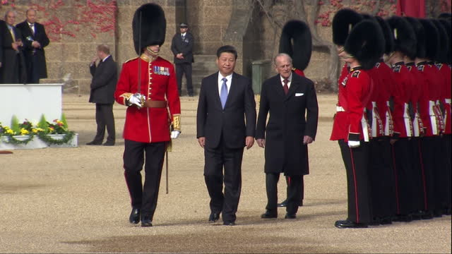 Exterior shots Prince Philip and Xi Jinping Chinese President inspect the Queen's Guard at Horse Guards Parade at start of Chinese State Visit on...