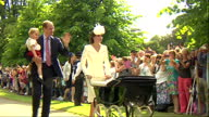 Exterior shots Prince William and Catherine Duchess of Cambridge walking past crowds after christening of Princess Charlotte of Cambridge Prince...