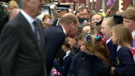 Exterior shots Prince william arrives exits car talks with waiting supporters and officials then enters building