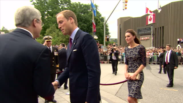 Exterior shots Prince William Catherine Duchess of Cambridge get out of car in Ottawa city centre to loud cheering crowds greet officials Royal Tour...