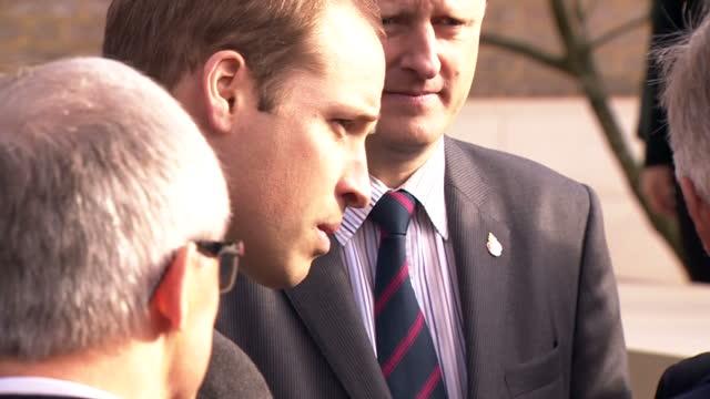 Exterior shots Prince William Duke of Cambridge King Philippe of Belgium wlk into Wellington Barracks forecourt and talk to memorial garden...