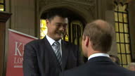 Exterior shots Prince William Duke of Cambridge talks with Yao Ming former Chinese basketball player outside the Maughan Library King's College...