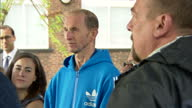 Exterior shots Prince William in garden speaking with group of patients and workers