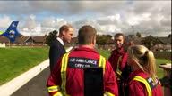 Exterior shots Prince William talking with Air Ambulance Paramedics