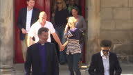 Exterior shots Princess Anne walks out from Canongate Kirk church followed by Mike Tindall Zara Phillips Mike Tindall Zara Phillips Wedding Rehearsal...