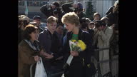 Exterior shots Princess Diana leaving Centrepoint House London greets and talks to members of the public holding a bouquet of flowers she tenderly...