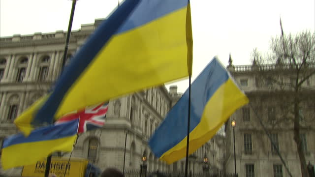 Exterior shots pro Ukraine demonstrators with flags banners on Whitehall on March 07 2014 in London England