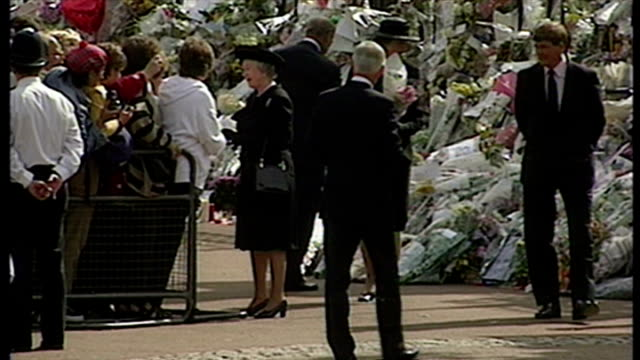 Exterior shots Queen and Prince Philip Duke of Edinburgh looking at floral tributes left for Princess Diana outside Buckingham Palace on in London...