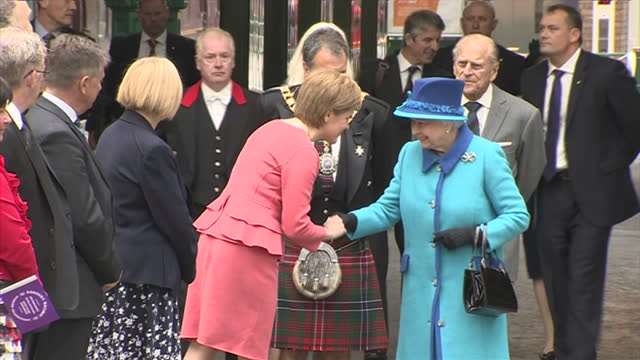 Exterior shots Queen Elizabeth II and Prince Philip Duke of Edinburgh arriving at Waverley Station and meeting First Minister Nicola Sturgeon and...