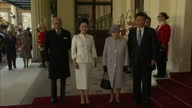 Exterior shots Queen Elizabeth II and Xi Jinping Chinese President get out of The Diamond Jubilee State Coach wait for Prince Philip and Peng Liyuan...