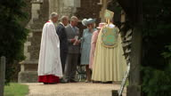 Exterior shots Queen Elizabeth II Prince Philip Duke of Edinburgh Prince Charles and Camilla Duchess of Cornwall standing outside Church of St Mary...