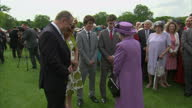 Exterior shots Queen Elizabeth II talking with guests at Buckingham Palace garden party on May 22 2014 in London England