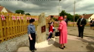 Exterior shots Queen Elizabeth II unveils plaque whilst on visit to Salvesen Gardens a new housing development for disabled veterans on July 02 2015...