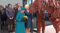 Exterior shots Queen Elizabeth II views War Horse theatre prop as she leaves the New School of Veterinary Medicine at the University of Surrey on...