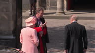 Exterior shots Queen Elizabeth Prince Philip get out of car greet church minister before walking into the Canongate Kirk church Queen Duke Arrive for...