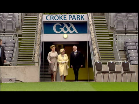 Exterior shots Queen Elizabeth walks onto Croke Park pitch with Irish President Mary McAleese Quee walks onto Croke Park Stadium Pitch on May 18 2011...