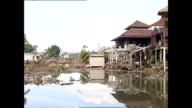 Exterior shots recovery team at work in and around destroyed houses in Khao Lak