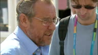 Exterior shots Richard Caborn Sports Minister walk around and chat to journalists on August 28 2004 in Athens Greece