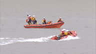 Exterior shots RNLI lifeboats search offshore at BurnhamonSea Somerset for missing four year old Dylan Cecil Exterior shots family members of missing...