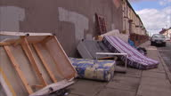 Exterior shots rubbish and old mattresses dumped on pavement of residential street on July 08 2015 in Liverpool England