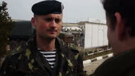 Exterior shots Russian troops surrounding Ukrainian army base shots inside the Ukrainian army baseDespite intense diplomatic moves to calm the...