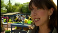 Exterior shots Samantha Cameron SamCam wife of Prime Minister David Cameron helping to paint door at Growing Zone Project in Kippax Exterior...