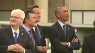 Exterior shots showing David Cameron British Prime Minister and President Barack Obama talking and laughing during Royal Air Force flypast on...