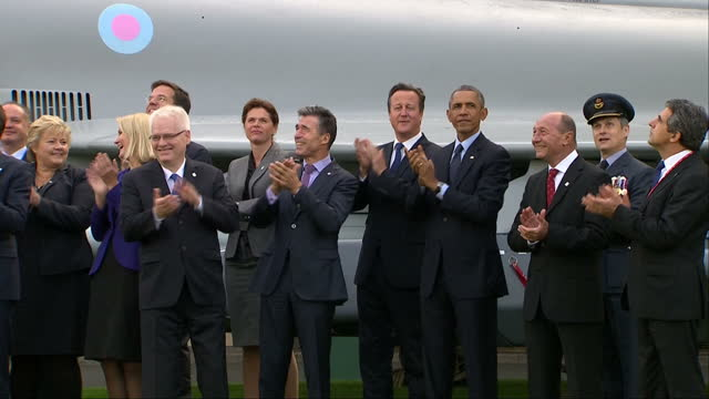 Exterior shots showing President Barack Obama David Cameron British Prime Minister and NATO Leaders watching and applauding at Red Arrows flypast on...