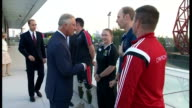 Exterior shots showing Prince Charles Prince of Wales Prince William Duke of Cambridge and Prince Harry talking with Invictus Games competitors ahead...