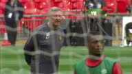 Exterior shots Sir Alex Ferguson leading training session with his Manchester United squad at Wembley stadium ahead of the 2011 UEFA Champions League...