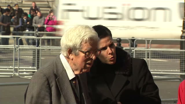 Exterior shots Sir Geoffrey Howe standing at entrance to Westminster Abbey on March 13 2014 in London England